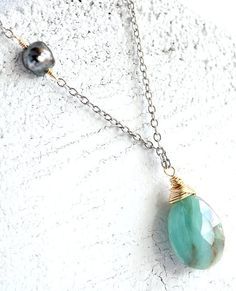 Black Tahitian pearl necklace. Tahitian keshi by KahiliCreations, $88.00. (There's my favorite blue opal!)