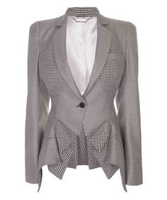 Alexander McQueen Mini-Dogtooth Multi-Panel Jacket.  Toss up between this board and my FIERCE board for this article of clothing.