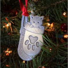 A happy kitten sitting cozy in a pair of mittens. A great stocking-stuffer for the animal lover on your list! Happy Kitten, Handmade Christmas, Christmas Ornaments, Stocking Stuffers, Mittens, Artisan, Cozy, Holiday Decor, Crafts