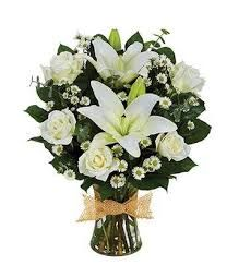 Peaceful bouquet, Send a graceful tribute in memory of a loved one with a beautiful hand arranged bouquet. Created with fresh white roses, white asiatic lilies and white Monte Casinos. Delivered with a keepsake glass vase with a decorative ribbon White Flower Arrangements, Funeral Flower Arrangements, Funeral Flowers, Sympathy Plants, Sympathy Flowers, Cheap Flowers, Flowers For You, Send Flowers, Condolence Flowers