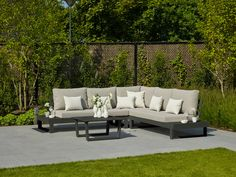 This outdoor corner sofa is very modern in its design but still very comfortable. The low level coffee table and handy integrated side tables mean theres plenty of space for drinks furniture luxury Ultra modern luxury garden furniture Luxury Garden Furniture, Pallet Garden Furniture, Outdoor Furniture, Corner Sofa Garden, Garden Sofa, Outdoor Lounge, Outdoor Living, Outdoor Decor, Corner Sofa With Cushions