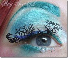 Mermaid makeup look with laser-cut paper eyelashes that are under the sea themed!
