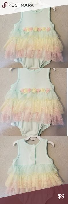 Fancy onesie size 12 months Fancy onesie size 12 months worn once excellent condition comes with matching head band One Pieces