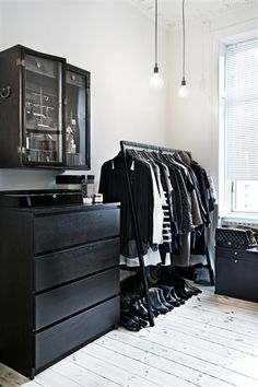 Black furniture white room. Might be a little too much contrast for a comfortable space.