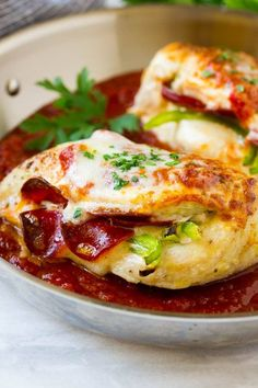 This pizza stuffed chicken is loaded with pepperoni, bell peppers and plenty of cheese, all topped with marinara sauce and baked to perfection.