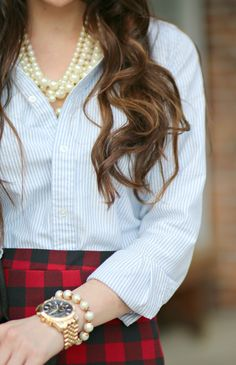 Channeling your most radiant self in a girlboss-approved red plaid pencil skirt and pearls.