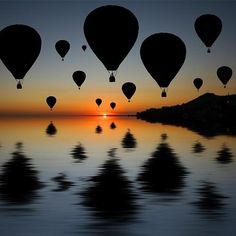 Go up in a hot air balloon! Wouldn't it be amazing to look down over that beautiful sunset?