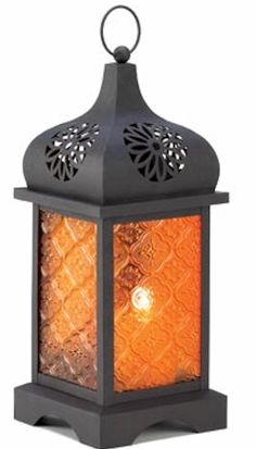 Sunset temple moroccan lantern. Like a temple tower at sunset, the pressed glass panels of this metal craft lantern blaze with a mystical desert glow. Simply set a candle inside to set the scene for after-dark magic. $21.00