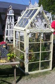Inspiration: Using old windows you can build a nice greenhouse. I have some old windows I'm saving for just such a project. Someday...