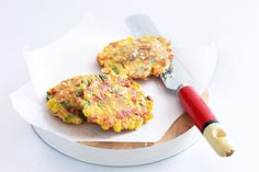 Fritter away a little spare time making this meal ahead, then reheat the sweet corn cakes and whip up the tangy salsa.