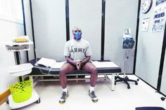 Staff Sgt. Michael Sapp, of Kimbrough Ambulatory Care Center's Preventive Medicine staff, demonstrates how to use the metabolic testing station at Fort Meade's new Army Wellness Center. (Photo by Noah Scialom)