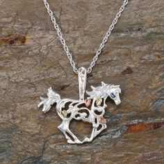 "1/2"" sterling silver and 12kt gold horseshoe pendant with diamond cut accents on 18"" rhodium plated sterling silver chain."