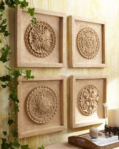 Four-Piece Wall Medallion Set $400 at Horchow - but could be made with ceiling medallions and mdf squares