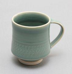 wheelthrown porcelain mug w/ celadon glaze by Hsinchuen Lin