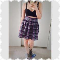 Purple/Grey Skirt A purple & grey plaid skirt from kimchi blue that I bought at UO. There is a sheen to it. The fit is M/L. If you're a large, it'll be more high waisted. If you're a medium, it'll sit more at the hips. It has a zipper in the back and pockets. No flaws! 70% polyester, 30% cotton. Urban Outfitters Skirts