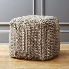 Shop profile pouf.   Woven wool blend piles on charm and comfort in casual, versatile form.  Neutral and solid square shape makes it mate well with just about any seating option or hold its own as stool.