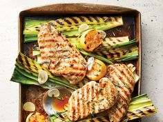 20-Minute Grilled Lemon-Rosemary Chicken and Leeks | Chicken cutlets get great flavor from a lemon-rosemary marinade while the leeks cook into a silky, caramelized vegetable side dish. If you've never enjoyed the darker green leek tops, give them a try in this recipe. The chicken marinade does double-duty here: it seasons the chicken while the leeks cook and then becomes a light sauce for the whole meal. If you can't find chicken cutlets, you can make your own: For 4 cutlets, cut two 8-ounce
