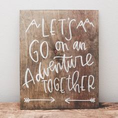 """Let's go on an adventure together."" Our wood signs are a lovely piece of art you can use as photo props, decor during your wedding or event, and as decoration for your home. Each piece is made to order; all wood is cut, stained, and painted directly in our home studio.If you would like a custom size, design, or stain color, please let us know.  Sign Details: As each piece is made to order, there will be some slight variation between the sign you receive and the one pictured in ..."