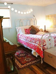 Guest bedroom including Pier 1 Antiqued Bird Clock and Paper Lanterns