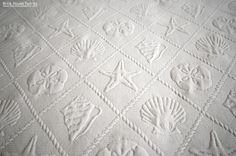 Seashell fabric ocean trellis starfish sand dollar cream - A sea shell scallop, sand dollar, star fish fabric. This matelasse fabric gives the effect is of a quilted fabric, it is neat!  #seashell #shell #ocean #starfish #sanddollar #cream #fabric #sewing #upholstery #beach #ocean #nautical #beachy #homedec #coastal #cottage #subtle #decor #homedecorating