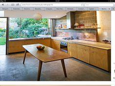 Plywood kitchen doors, copper splashback, polished concrete floor