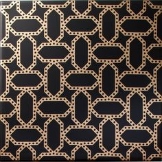 Arabesque - Kamal Gold on Black Tiles. A black tile with a liquid gold geometric…