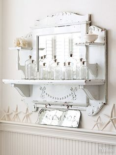 You don't need an entire mantel or a complete fireplace surround to create a statement. This carved mantelpiece -- once part and parcel of a larger mantel -- steps up as a good-looking bathroom furnishing. It provides an interesting shape, a mirror that accommodates primping, and shelves for displaying antique bottles, pieces of coral, and a vintage vessel. /