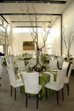 Branch centerpieces + green and white @ OC Art Museum