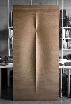 One very lust worthy wood door with peephole by Williamson Chong Architects...