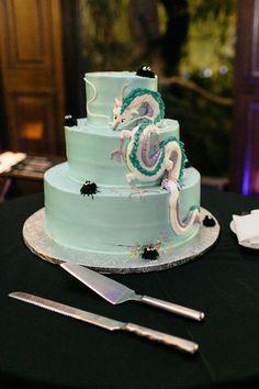 Dinosaur topiaries and punk rock shoes at this museum wedding | Offbeat Bride Ghibli wedding cake!
