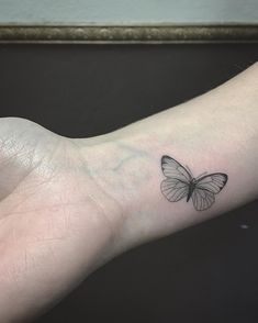 Minimal butterfly tattoo by @east_ssc