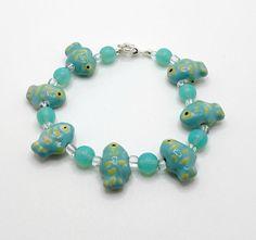 Fish Bead Bracelet With Aqua Ceramic Fish and Aqua Polished Stone Beads