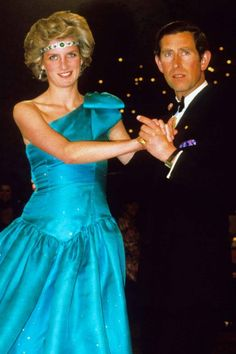 The Dress: An Emanuel sparkling turquoise dress. The Occasion: A black tie dance on the Royal tour of Australia, spring 1983. Why We Love It: While the frock is fabulous enough, we love the dare-devil addition of diamonds and emeralds (here, her necklace is worn as a headband). Diana-1983-Emanuel-Australia-PA