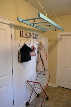 DIY Organization : Ladder Laundry Rack. Love it! Remember to paint chains the same color as walls to keep the ladder the focal point.