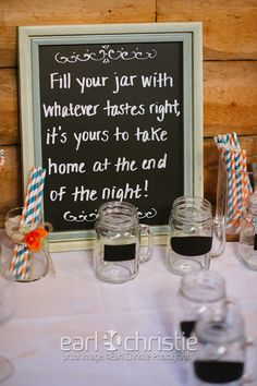 fill your own mason jars with chalk boards so guests could write their names on them! I loved the paper straws in our wedding colors and the easy cheap chalkboard signs!  Chalk boards for sale: http://www.tradesy.com/weddings/wedding-decorations/chalkboard-frames-558041