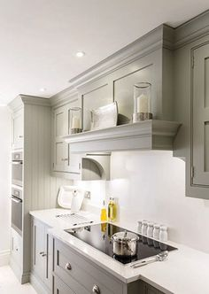Nice soft gray, simple hood solution for a low ceiling.