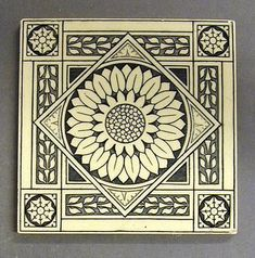 "Minton Hollins and Co transfer printed dust-pressed tile, a sunflower in an elaborate border. Printed in monochrome, probably designed by John Windsor Bradburn, 6"" sq, c1880"