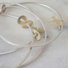 It's always so wonderful when clients want something a little different. Fresh off the bench; our dancers bangle with gold charms and a special little monkey charm (this one was so much fun to make!