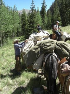 Adjusting the packs on our pack horses during a pack trip with Zapata Ranch. Barn Art, Photo Grouping, Ranch Life, Backpacking Gear, Trail Riding, Cowboy And Cowgirl, Outdoor Life, Wyoming, Cattle