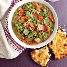 Our Best Curry Recipes | Quick Chicken and Vegetable Curry with Garlic Naan  | MyRecipes.com