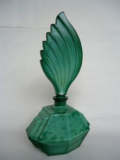 Una botella de perfume de cristal de malaquita