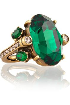 I love this odd statement ring for many reasons...the random mix-match of jewels placed about, the emeralds used within, the gold plated ring with diamonds throughout, and just the overall appeal of this beast.