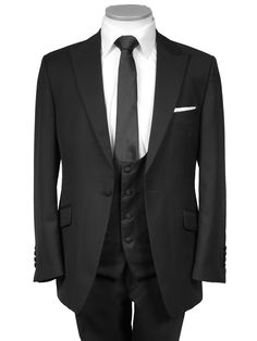 We think this is it. With the waistcoat in another colour (grey). And the shirt will have a contrasted collar... And the tie will be green... But you get the shape and the vibe, don't you?