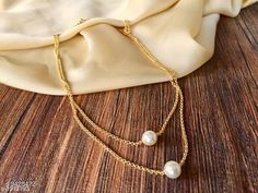 Necklaces & Chains Women's Pearl And Gold Plated Necklaces & Chains Base Metal: Alloy Plating: Gold Plated Stone Type: Pearls Sizing: Short Sizes: Country of Origin: India Sizes Available: Free Size   Catalog Rating: ★4 (7946)  Catalog Name: Twinkling Chunky Women Necklaces & Chains CatalogID_1655861 C77-SC1092 Code: 011-9428472-141