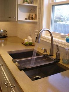 New Kitchen Sinks No kitchen remodel is complete without a new kitchen sink this this is actually a great color counter with the black sink concrete countertop sink workwithnaturefo