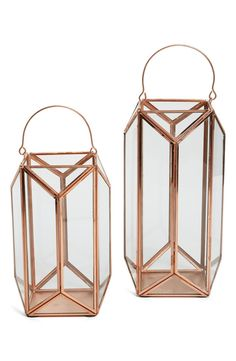 A contemporary lantern crafted from gleaming copper and clear glass is sure to brighten any space in your home.