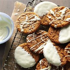 Dipped Gingersnaps Recipe -I get a great deal of satisfaction making and giving time-tested yuletide treats like these soft, chewy cookies. Dipping them in white chocolate makes great gingersnaps even more special.                                          —Laura Kimball, West Jordan, Utah