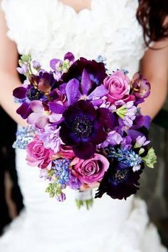 Beautiful purple and pink wedding bouquet. These will be my wedding colors. They're so gorgeous! The dress is gorgeous also!
