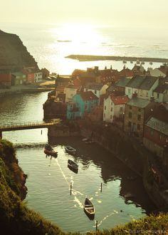 This is Staithes, a seaside village in North Yorkshire, England, by the North Sea. Formerly one of the largest and most productive fishing centres in England, it is now mainly a tourist town (and for good reason—it's lovely! Oh The Places You'll Go, Places To Travel, Places To Visit, Magic Places, Seaside Village, Voyage Europe, All Nature, To Infinity And Beyond, Future Travel