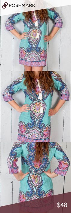 """Boho tunic dress With its bright, vibrant colors & boho details, this lightweight & airy tunic/ dress is sure to be your new favorite. Just add some wedges or sandals & you're ready for any occasion. 3/4 length sleeves, split neckline with tasked rope tie. 100% rayon. Bust:22"""", length:33"""" Dresses Mini"""
